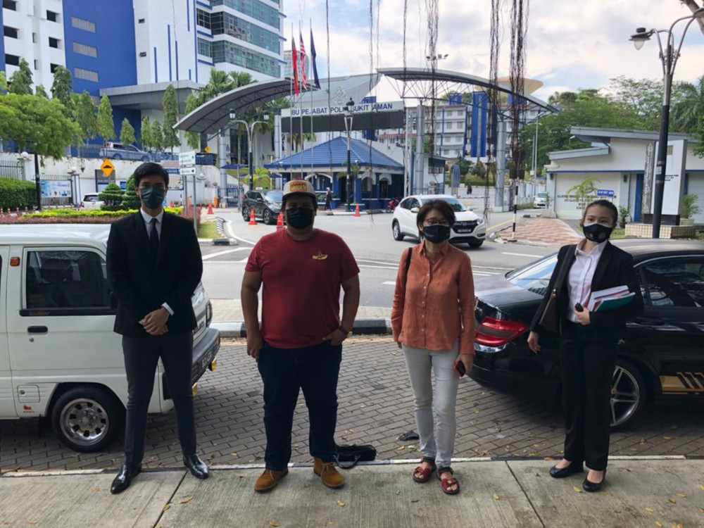 Filmmaker Anna Har (2nd right) and cartoonist Amin Landak (2nd left) with their lawyer Rajsurian Pillai (left) at Bukit Aman, July 2, 2021. — Picture from Twitter/freedomfilmfest