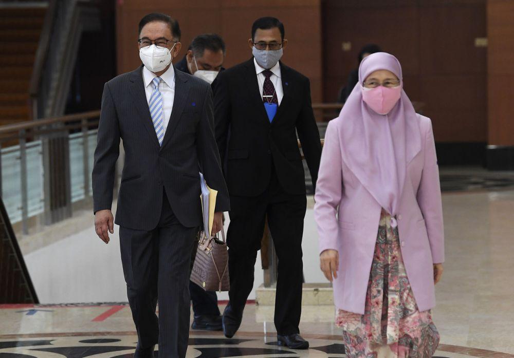 Opposition Leader Datuk Seri Anwar Ibrahim and his wife Datuk Seri Dr Wan Azizah Wan Ismail are pictured at Parliament, Kuala Lumpur July 29, 2021. — Bernama pic