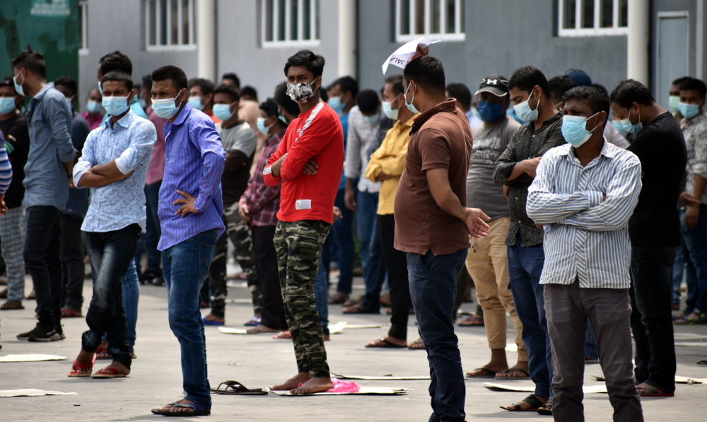 Foreign workers at a factory in the Ayer Keroh Industrial Area wait to get swabbed for Covid-19 in Melaka, July 8, 2021. — Bernama pic