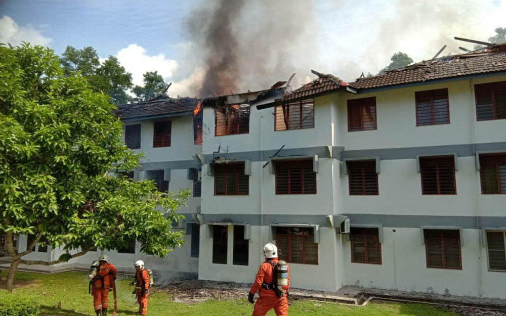 Four rooms at the Universiti Utara Malaysia (UUM) student hostel block in Sintok were damaged in a fire incident on the third floor of the building July 20, 2021. — Picture via Twitter/Bernama