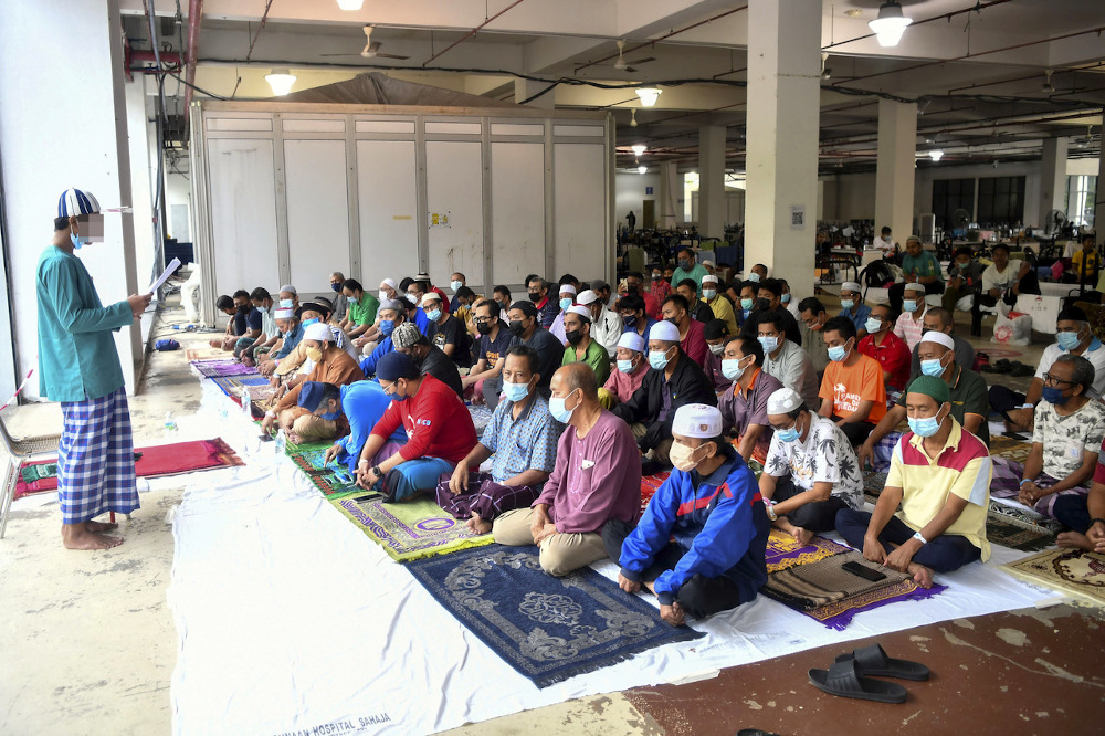 An imam leads Aidiladha prayers at the Covid-19 Low-Risk Quarantine and Treatment Centre at the Malaysia Agriculture Expo Park 2 in Serdang on Hari Raya Aidiladha July 20, 2021. — Bernama pic
