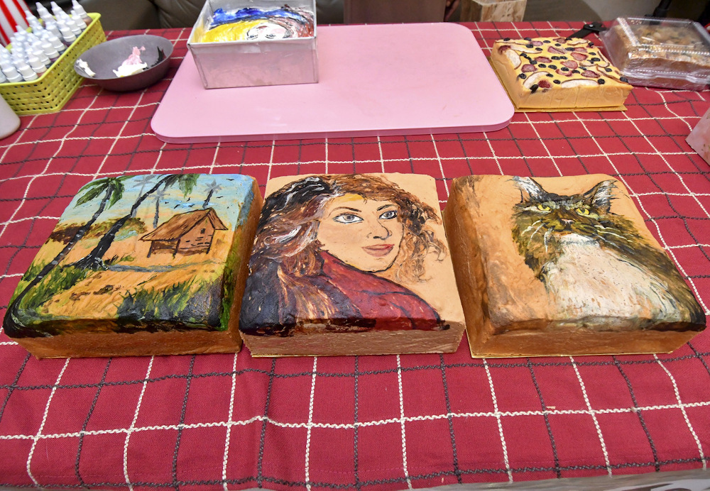 Marble cakes featuring scenery, a woman and a cat made by Aftisa Ahmad Fahmy are seen at her home in Kampung Belukar, Panji July 13, 2021. — Bernama pic
