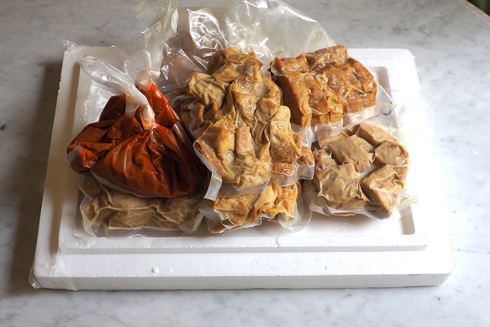 The snacks are frozen, vacuum packed and sent over in a foam box to your doorstep.