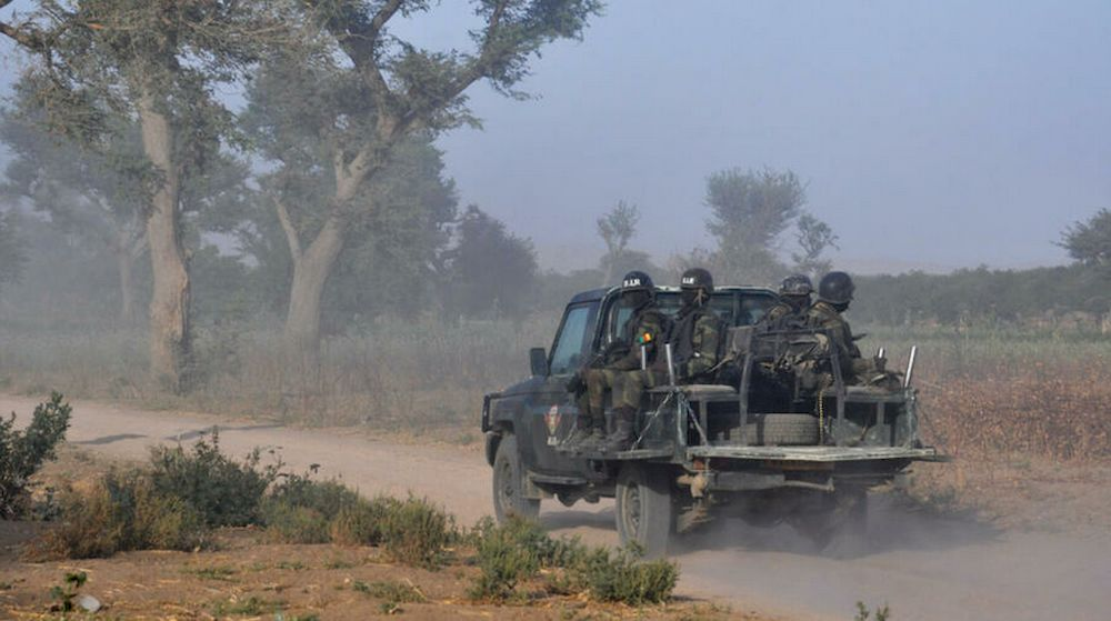 Members of the Cameroonian Rapid Intervention Force patrol on the outskirts of Mosogo in the Far North Region of the country, where Boko Haram has been active since 2013, on March 21, 2019. — AFP pic