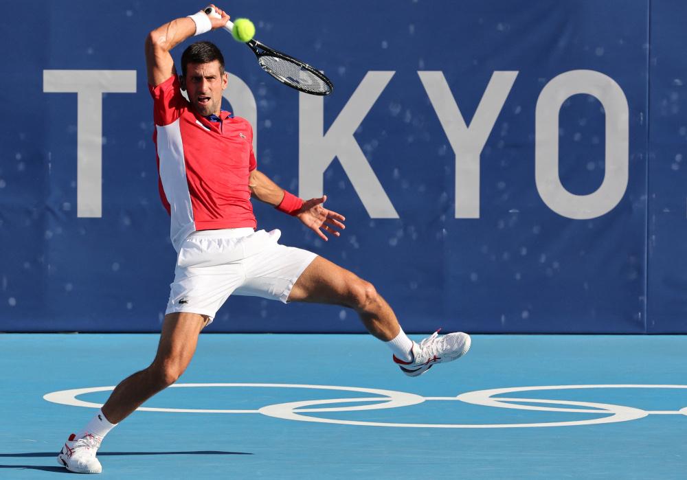 Serbia's Novak Djokovic returns the ball to Spain's Alejandro Davidovich Fokina during their Tokyo 2020 Olympic Games men's singles third round tennis match at the Ariake Tennis Park in Tokyo July 28, 2021. — AFP Pic