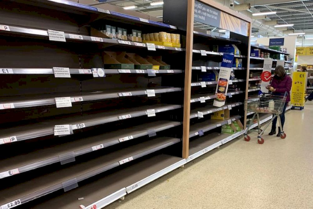 File picture shows a woman pushing her trolley along the empty pasta aisle inside a Tesco supermarket amid the coronavirus disease (Covid-19) outbreak in Manchester, Britain, March 21, 2020. — Reuters pic