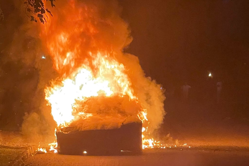 This handout image released by law firm Geragos & Geragos shows a Tesla Model S Plaid in flames in a suburb of Philadelphia, Pennsylvania, on June 29, 2021. — Geragos & Geragos / AFP pic
