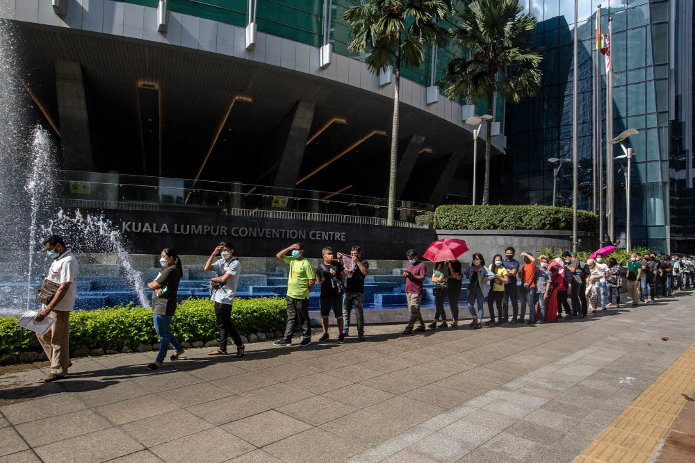 Foreign workers are seen at the KLCC vaccination centre to receive their Covid-19 jab July 28, 2021. — Picture by Firdaus Latif