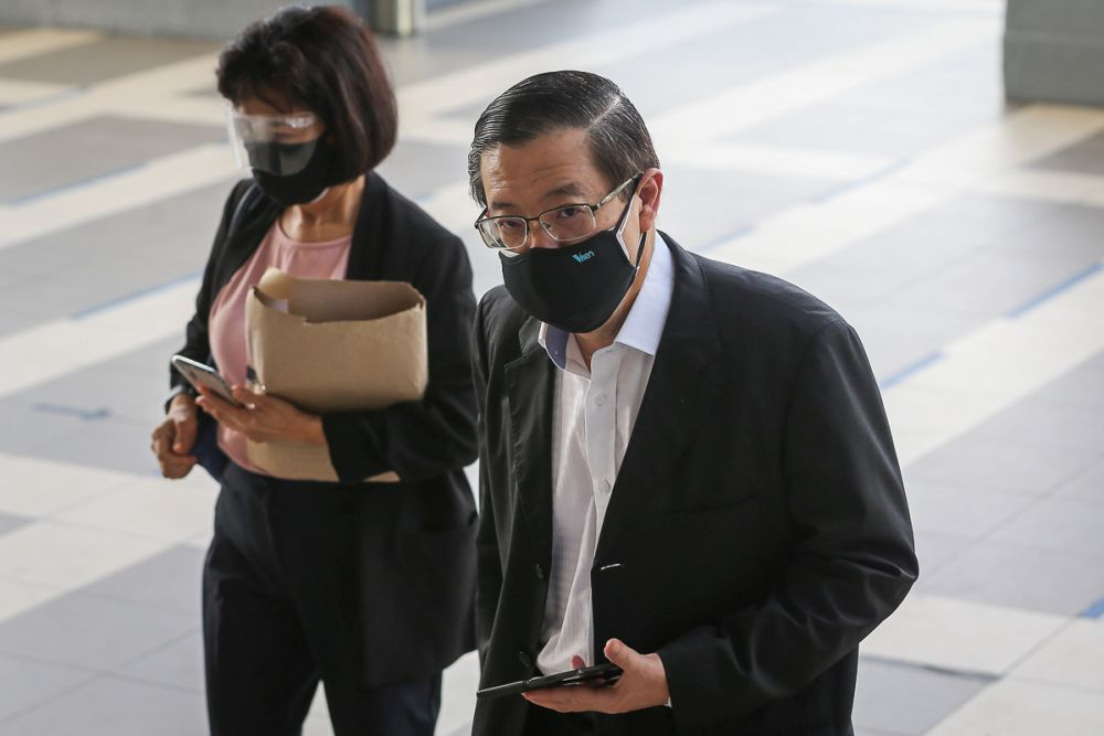 Former Penang Chief Minister Lim Guan Eng and his wife Betty Chew Gek Cheng arrive at the Kuala Lumpur High Court July 15, 2021. — Picture by Yusof Mat Isa