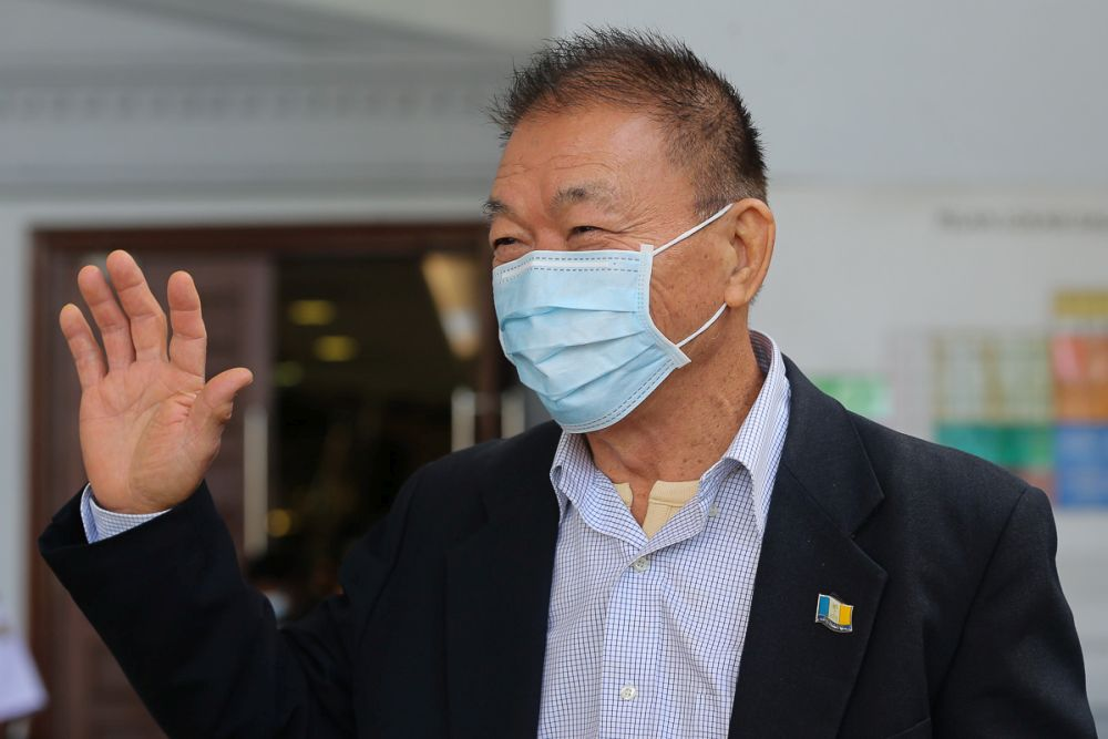 Former Penang executive councillor Lim Hock Seng is pictured at the Kuala Lumpur High Court July 15, 2021. — Picture by Yusof Mat Isa