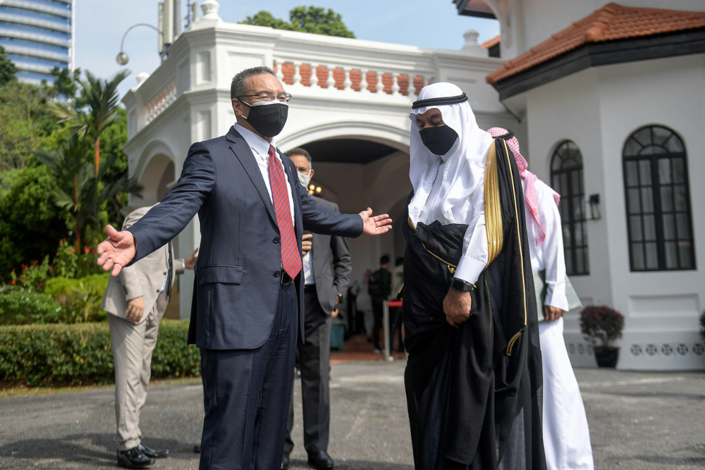 Senior Foreign Minister (Security Cluster) Datuk Seri Hishammuddin Hussein with Saudi Arabia's Ambassador to Malaysia Datuk Mahmoud Hussien Saeed Qattan after the handing over ceremony of Saudi's government Covid-19 aid for Malaysia at the Institute Of Strategic & International Studies, July 30, 2021. — Bernama pic