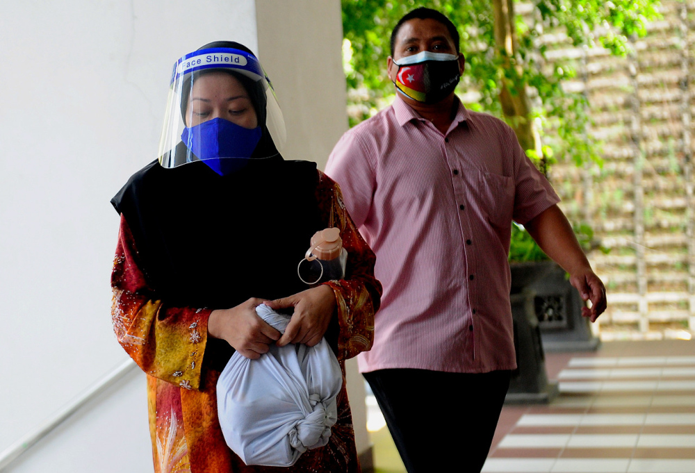 Former journalist Wan Norhayati Wan Alias or better known as Ibu Yati, today pleaded not guilty in the Selangor Syariah High Court to expounding religious doctrines contrary to Islamic law and spreading them through Facebook. — Bernama pic