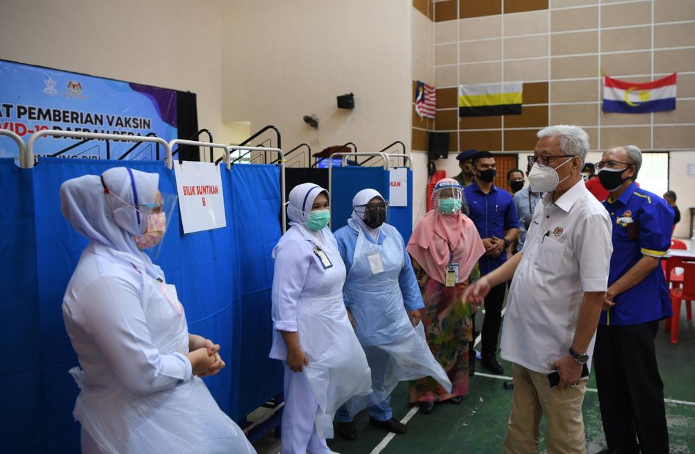 Datuk Seri Ismail Sabri Yaakob visits the vaccination centre (PPV) at Dewan Semai Bakti Felda Sebertak in Bera, July 6, 2021. — Bernama pic