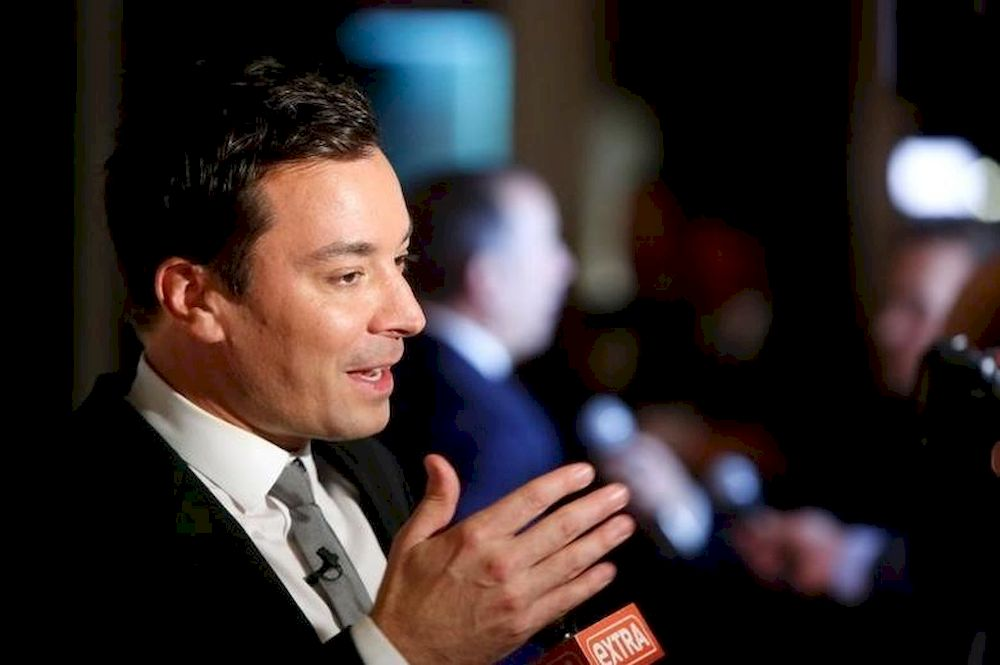 File picture shows television show host Jimmy Fallon talking to reporters on the red carpet for the taping of the Mark Twain Prize for Humor ceremony and performance at the Kennedy Center in Washington October 19, 2014. — Reuters pic