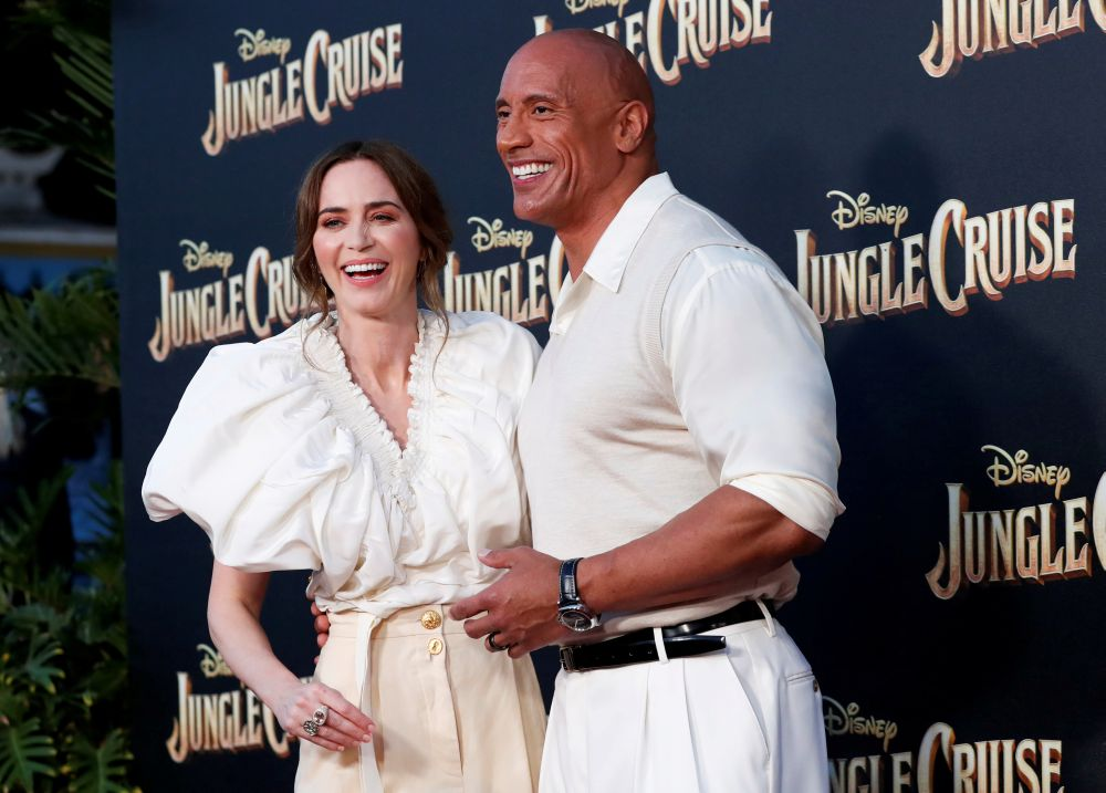 Cast members Dwayne Johnson and Emily Blunt attend the premiere for the film 'Jungle Cruise' at Disneyland Park in Anaheim, California July 24, 2021. — Reuters pic
