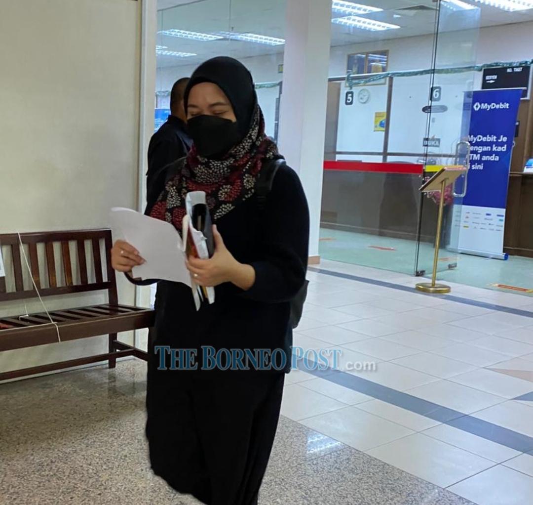 Dina Azanina Morshidi leaving the Kuching Court after paying the fine. ― Borneo Post pic
