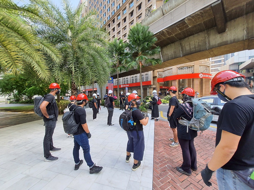 A crowd gathering at the Masjid Jamek LRT Station ahead of the #Lawan protest, July 31, 2021. ― Picture by Shafwan Zaidon