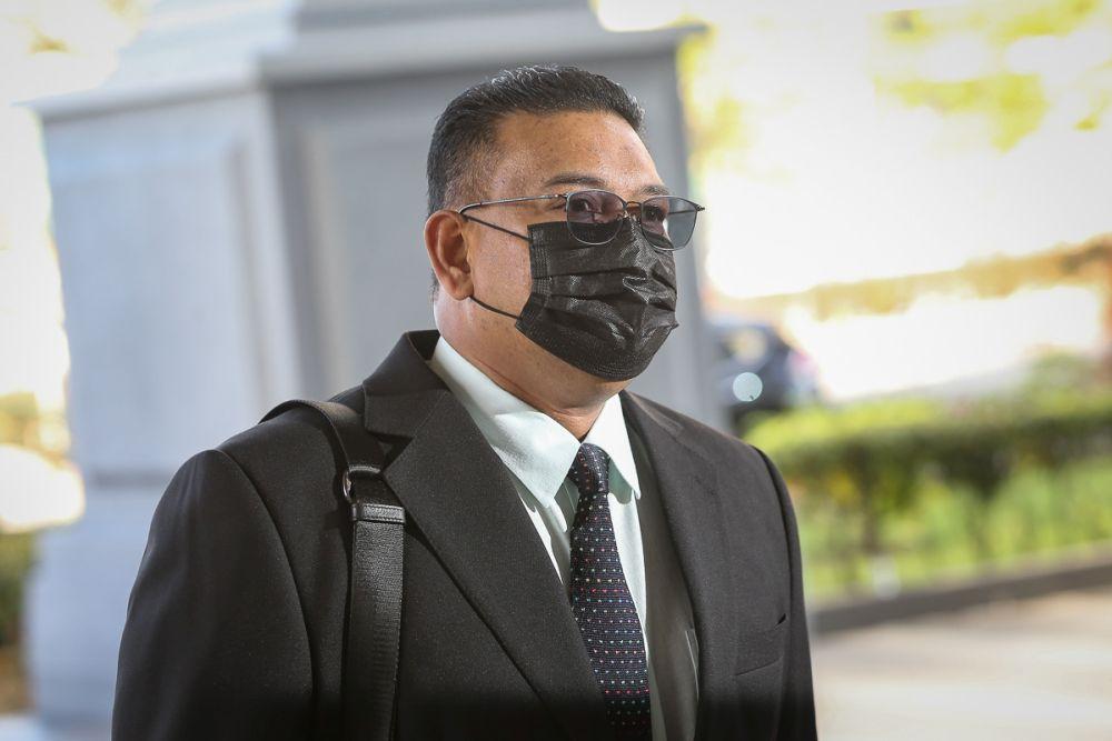 Datuk Lokman Noor Adam arrives at the Kuala Lumpur High Court July 15, 2021. — Picture by Yusof Mat Isa