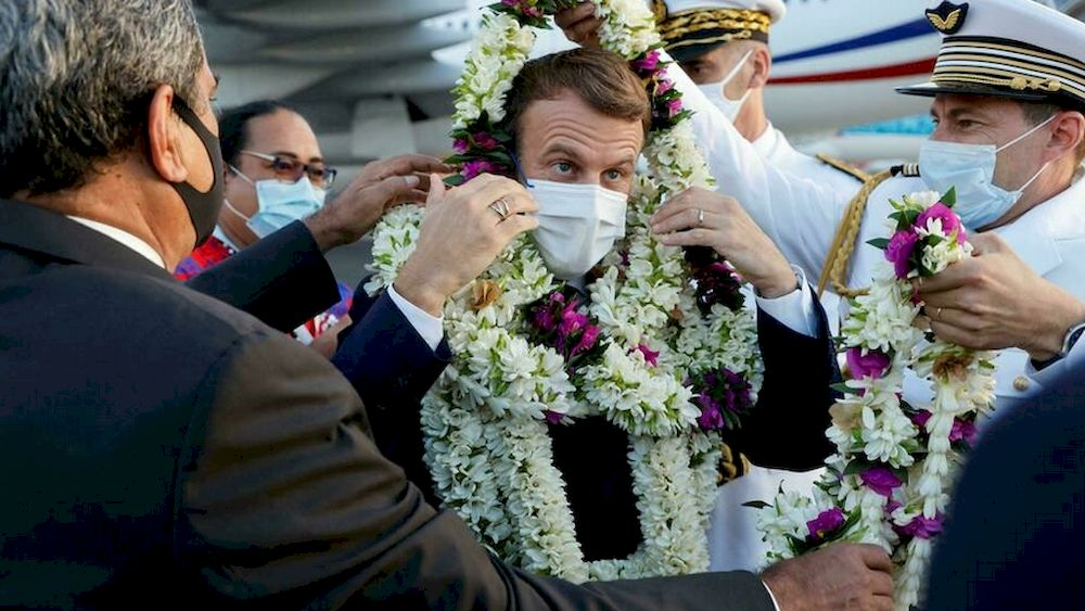 President Emmanuel Macron (centre) is making his first official trip to French Polynesia. — AFP pic