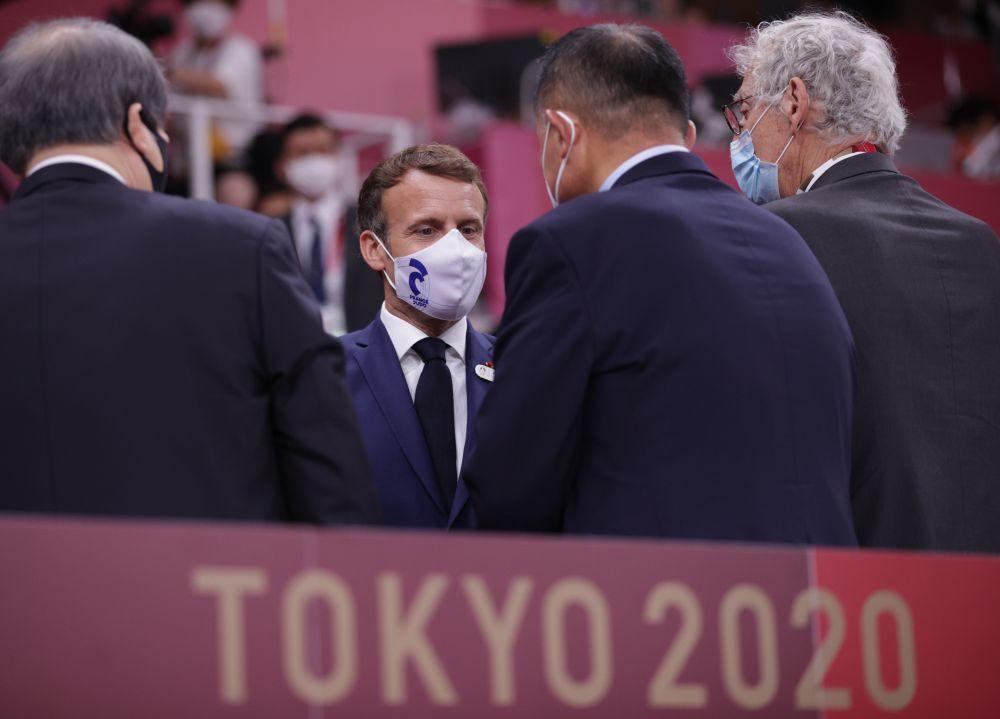 France's President Emmanuel Macron attends a judo match at Nippon Budokan, Tokyo July 24, 2021. — Reuters  pic