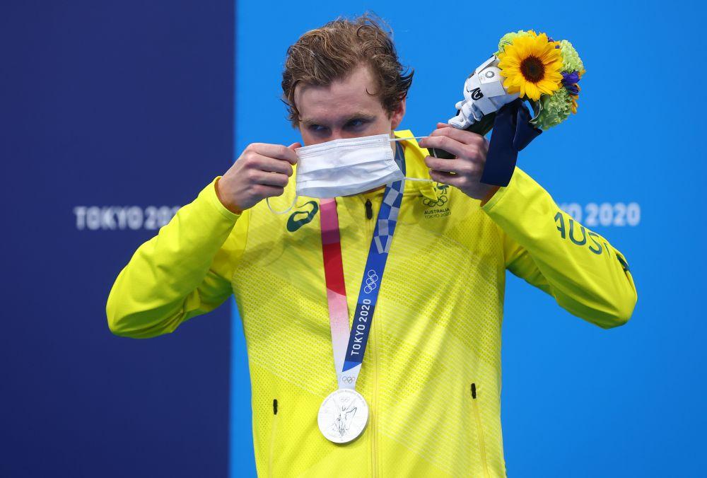 Silver medalist Jack McLoughlin of Australia puts on a face mask at the Tokyo Aquatics Centre July 25, 2021. — Reuters pic