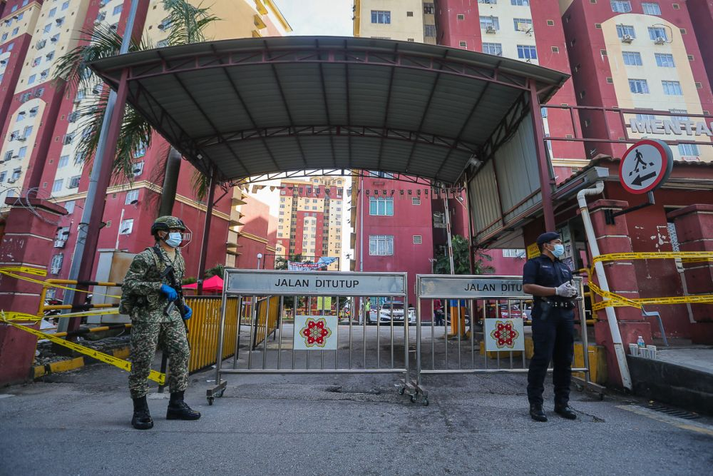Armed Force and police personnel are pictured at the entrance of Mentari Court in Sunway, which has been placed under the enhanced movement control order July 1, 2021. ― Picture by Yusof Mat Isa