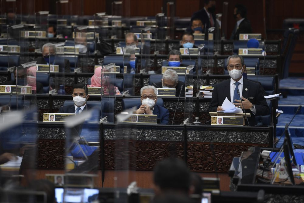 Prime Minister Tan Sri Muhyiddin Yassin delivers his statement on the National Recovery Plan during a special Parliament sitting in Kuala Lumpur July 26, 2021. — Bernama pic