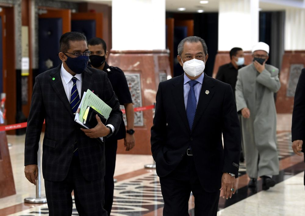 Prime Minister Tan Sri Muhyiddin Yassin and Law Minister Datuk Seri Takiyuddin Hassan are pictured at Parliament, Kuala Lumpur July 27, 2021. — Bernama pic