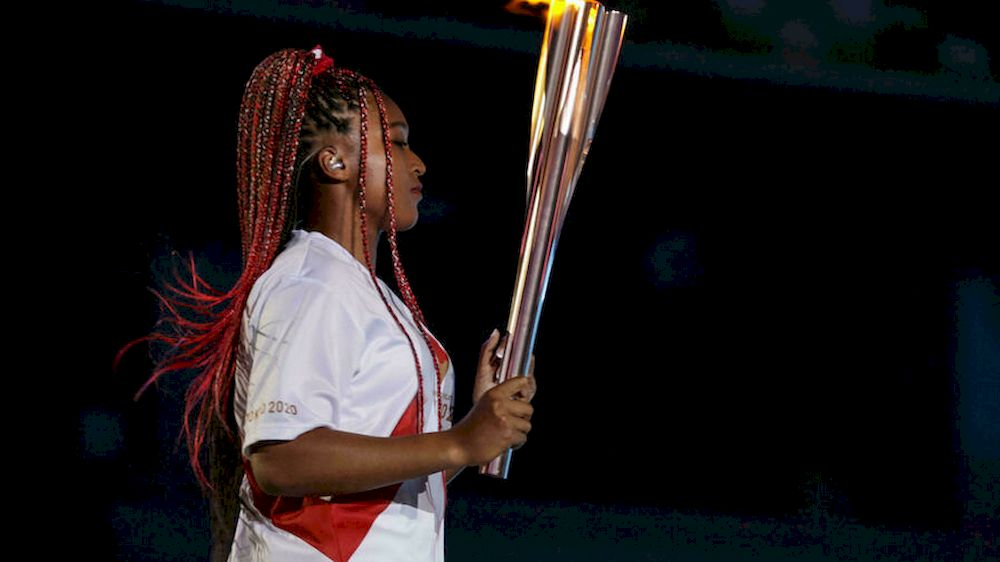 Japanese-Haitian tennis star Naomi Osaka lit the Olympic cauldron in the crowning moment of the opening ceremony. — AFP pic