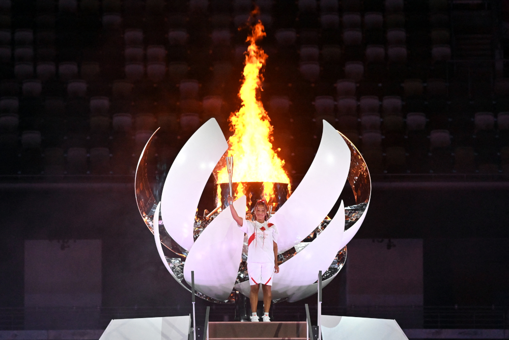 Japanese tennis player Naomi Osaka poses after lighting the Olympic Cauldron with the Olympic flame during the opening ceremony of the Tokyo 2020 Olympic Games, at the Olympic Stadium, in Tokyo, on July 23, 2021. — AFP pic