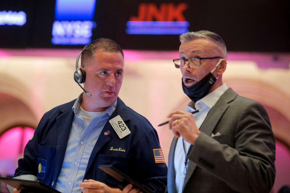 Traders work on the floor of the New York Stock Exchange (NYSE) in New York City July 21, 2021. — Reuters pic