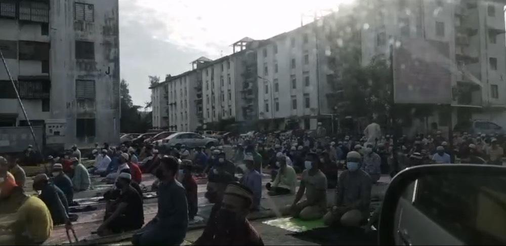 A crowd of around 200 people performing Aidiladha prayers outside a surau in Juru, Penang July 20, 2021. — Video screencap from social media