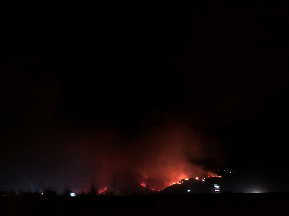 Flames rise as a wildfire burns on a hill in Kamloops, British Columbia, Canada July 1, 2021, in this picture obtained from social media. — Picture via Twitter/@lexi_bellsy