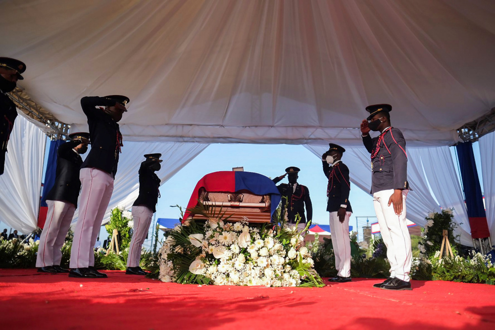 Pallbearers in military attire salute next to a coffin holding the body of late Haitian President Jovenel Moise after he was shot dead at his home in Port-au-Prince earlier this month, in Cap-Haitien, July 23, 2021. — Reuters pic