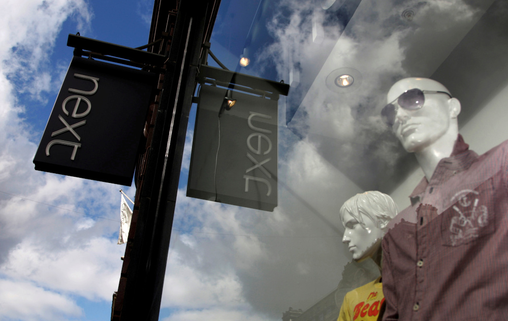 Mannequins are pictured in the window of a Next clothing store in London March 26, 2009. — Reuters pic