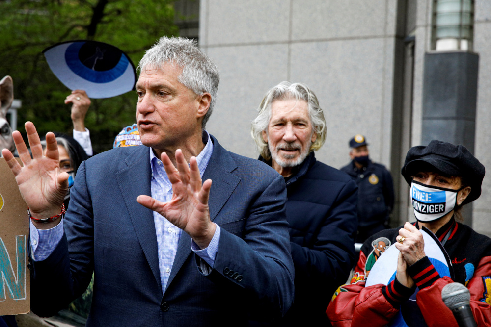 Attorney Steven Donziger, who won a multi-billion-dollar judgment against Chevron on behalf of Ecuadorian villagers, speaks to supporters with singer Roger Waters and actor Susan Sarandon, as he arrives for his criminal contempt trail at the Manhattan Federal Courthouse in the Manhattan borough of New York May 10, 2021. — Reuters pic