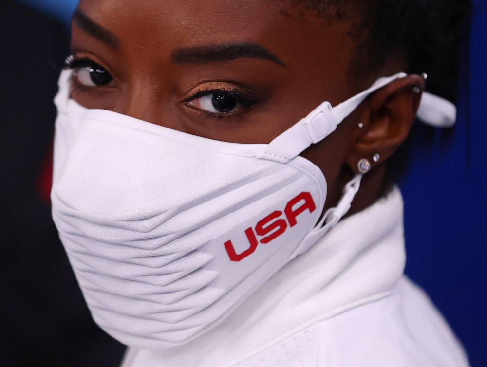 Silver medallist Simone Biles of the United States wearing a protective face mask looks on at the Ariake Gymnastics Centre, Tokyo July 27, 2021. — Reuters pic