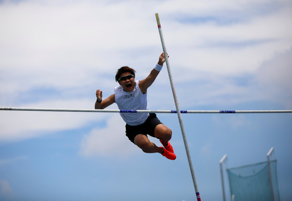 So Sato, 25, a deaf and transgender pole vaulter, works out during a camp training with other deaf athletes in Utsunomiya, north of Tokyo, Japan July 10, 2021. — Reuters pic