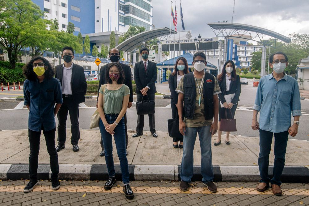 (From left) Mohammad Alshatri, Sharon Wah, Suaram executive director Sevan Doraisamy and Kua Kia Soong are seen with their lawyers at Bukit Aman in Kuala Lumpur July 6, 2021. — Picture by Fidaus Latif