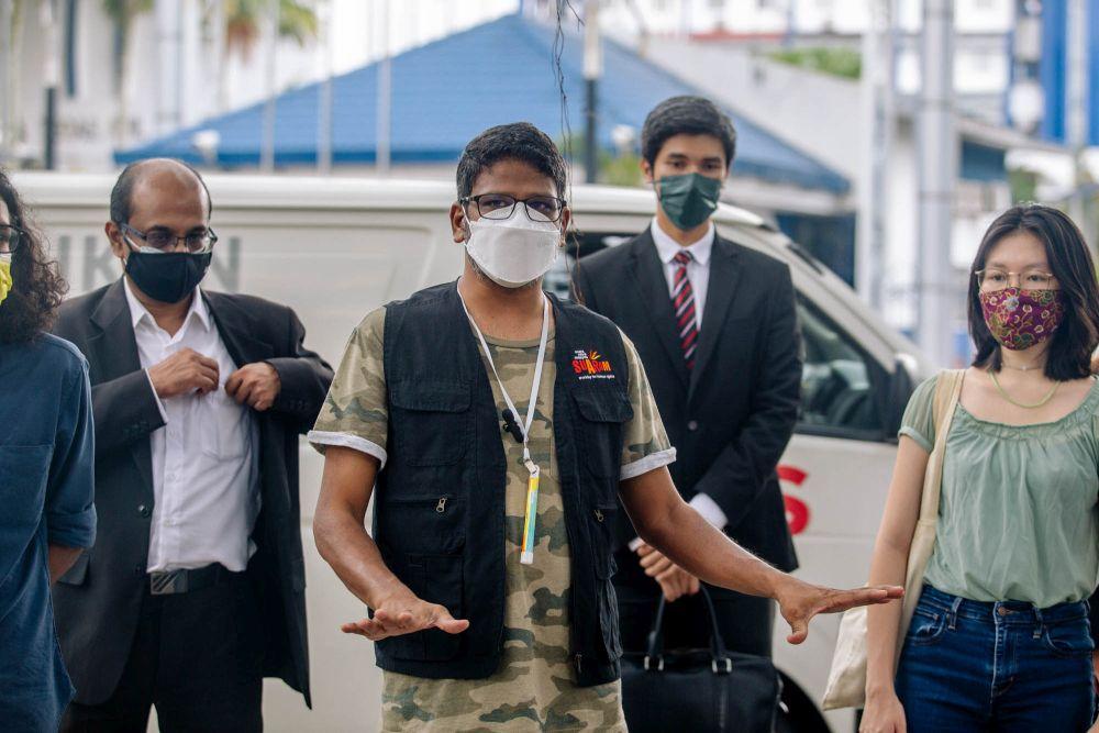 Suaram executive director Sevan Doraisamy speaks to reporters outside Bukit Aman in Kuala Lumpur July 6, 2021. — Picture by Firdaus Latif