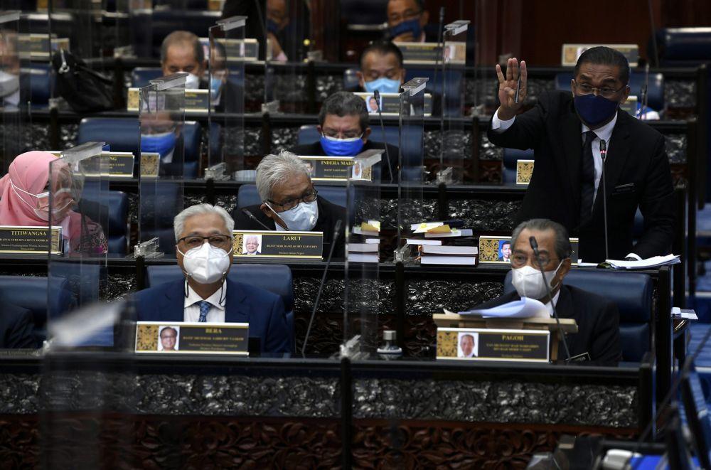 Datuk Seri Takiyuddin Hassan addresses members of Parliament during a special sitting on July 26, 2021. — Bernama pic