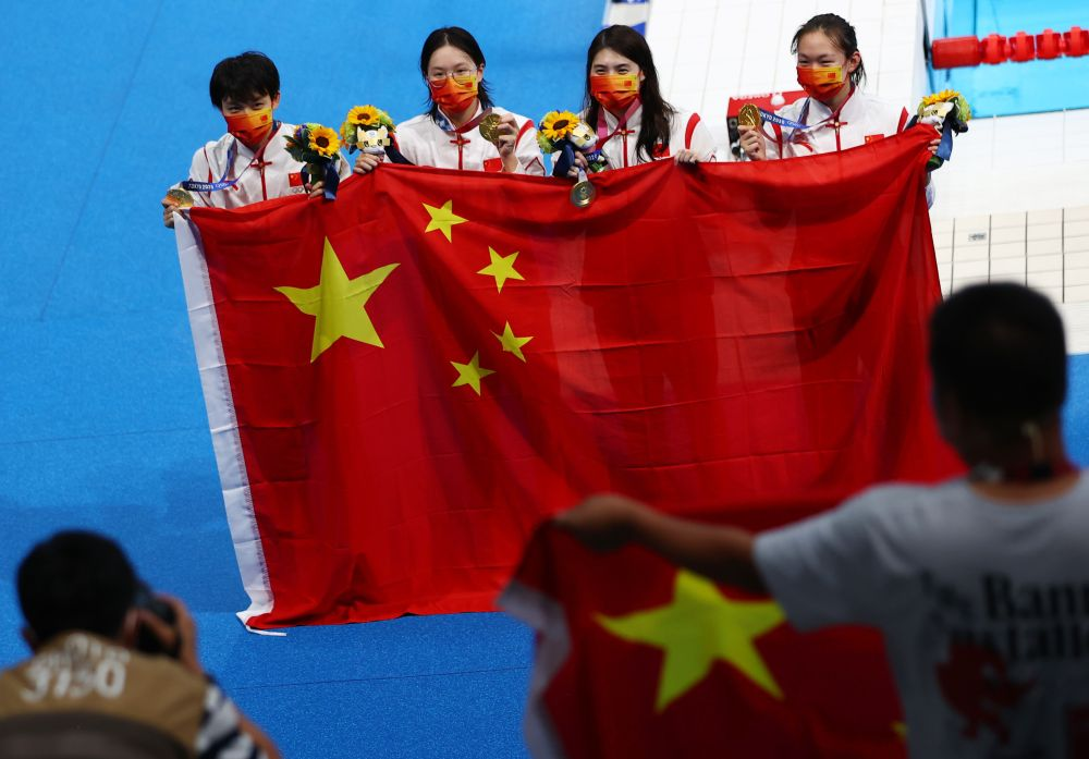 Team China celebrate after winning and setting a world record at the women's 4 x 200m freestyle at the Tokyo Aquatics Centre July 29, 2021. — Reuters pic
