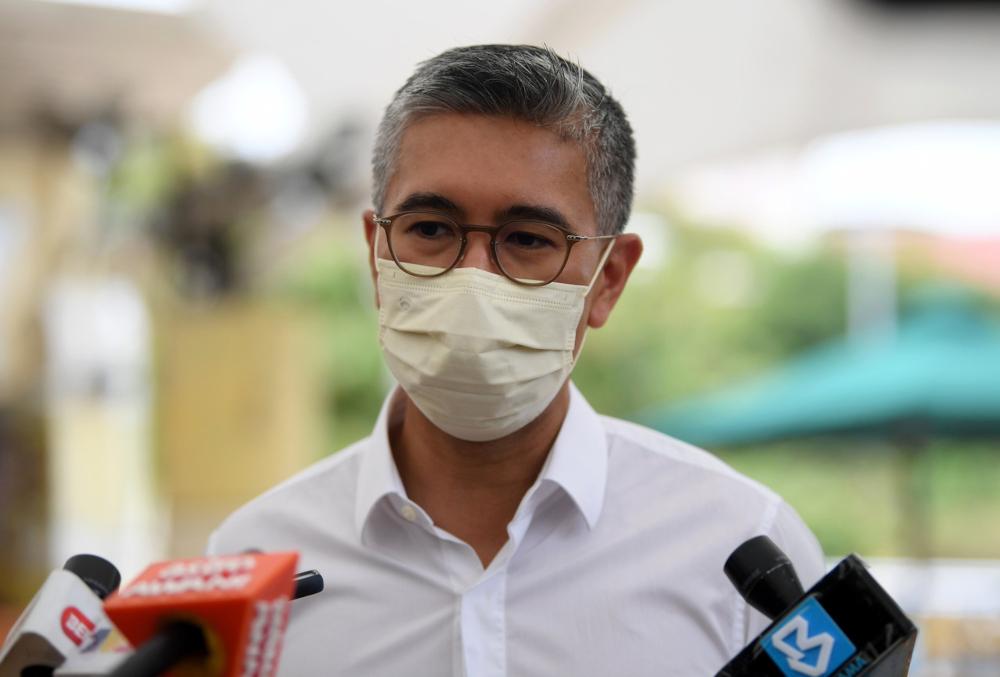NRP Coordinating Minister Datuk Seri Tengku Zafrul Abdul Aziz speaks to the media after conducting a survey at Kiosk D'Harmoni@9 and Precinct 9 Food Court in Putrajaya, July 14, 2021. — Bernama pic