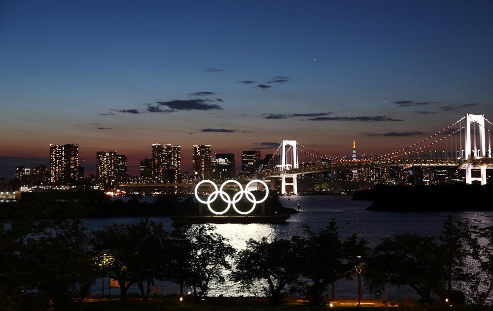 The Olympic Rings are seen in front of the skyline during sunset one night ahead of the official opening of the Tokyo 2020 Olympic Games in Tokyo, Japan, July 22, 2021. — Reuters pic