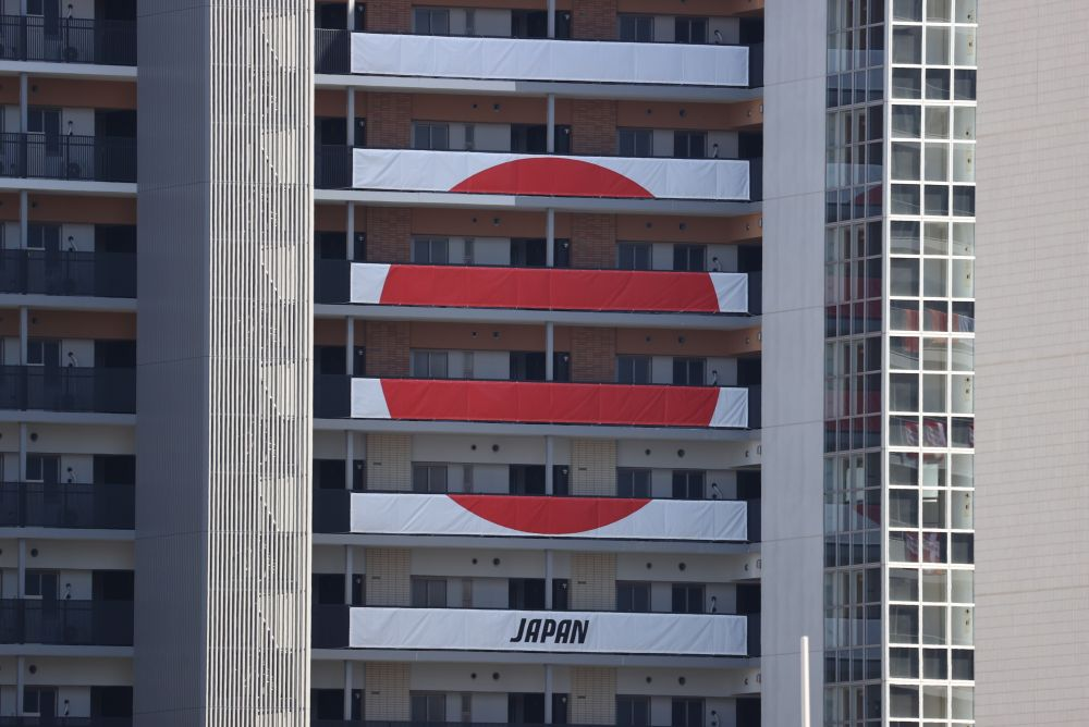 Signs from the Japan Olympic team hang on the apartment building hosting Olympics participants at the Athletes Village in Tokyo July 18, 2021. — Reuters pic