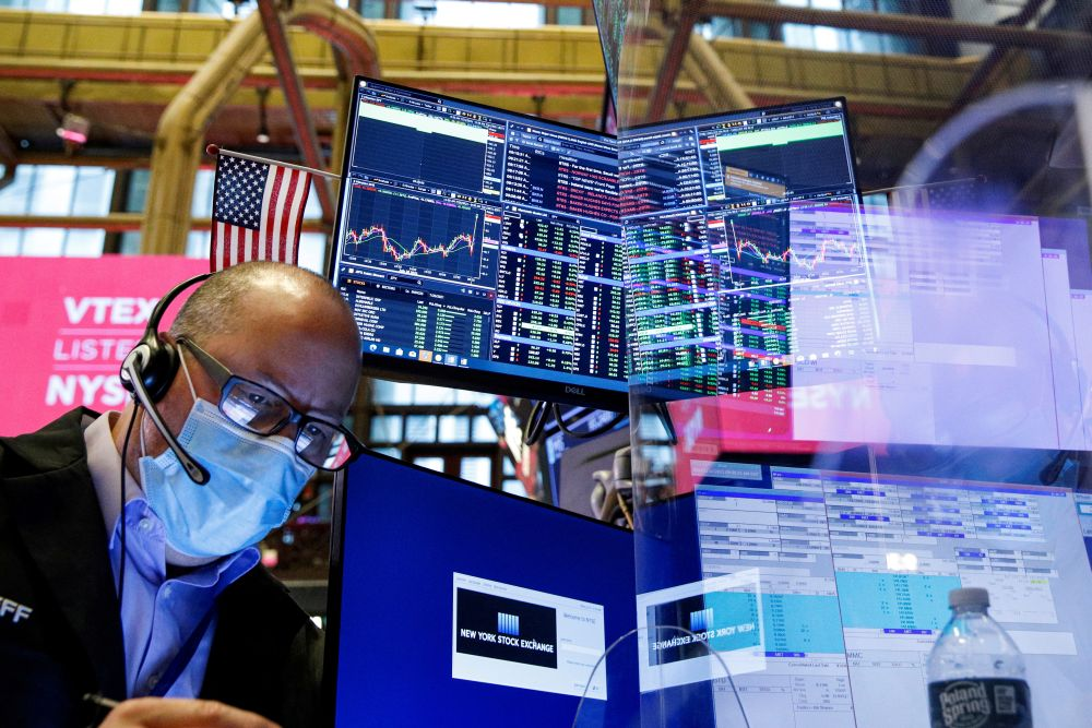 A trader works on the floor of the New York Stock Exchange in New York City, New York July 21, 2021.  — Reuters pic