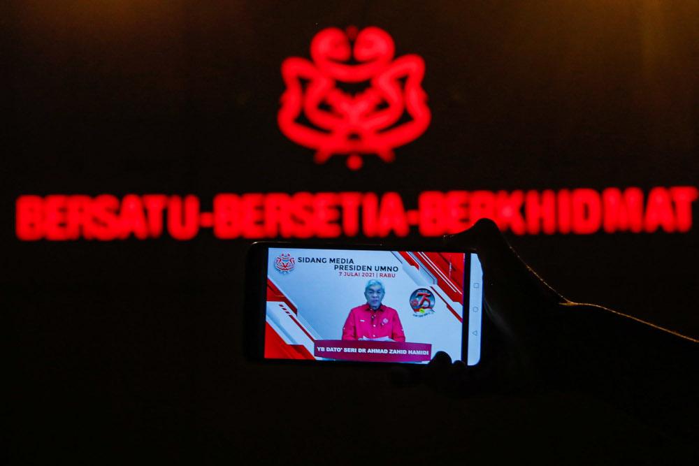 A livestream of Umno president Datuk Seri Ahmad Zahid Hamidi's online press conference at Umno headquarters in Kuala Lumpur, July 7, 2021. — Picture by Hari Anggara