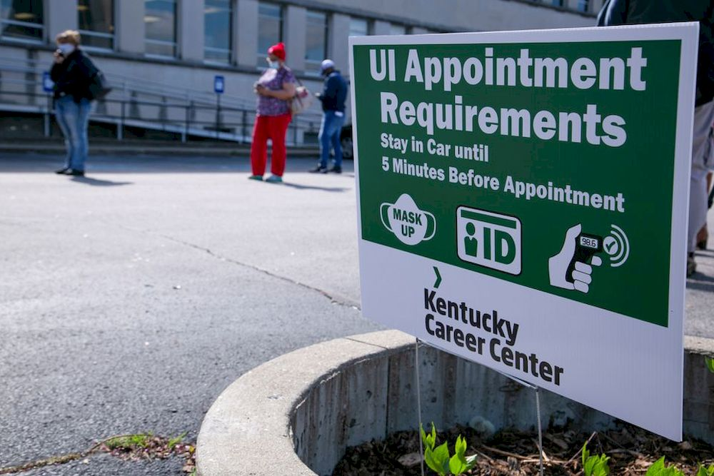 File picture shows people waiting in line as Kentucky Labor Cabinet reopens 13 Regional Career Centers for in-person unemployment insurance services, in Louisville, Kentucky, US, April 15, 2021. — Reuters pic