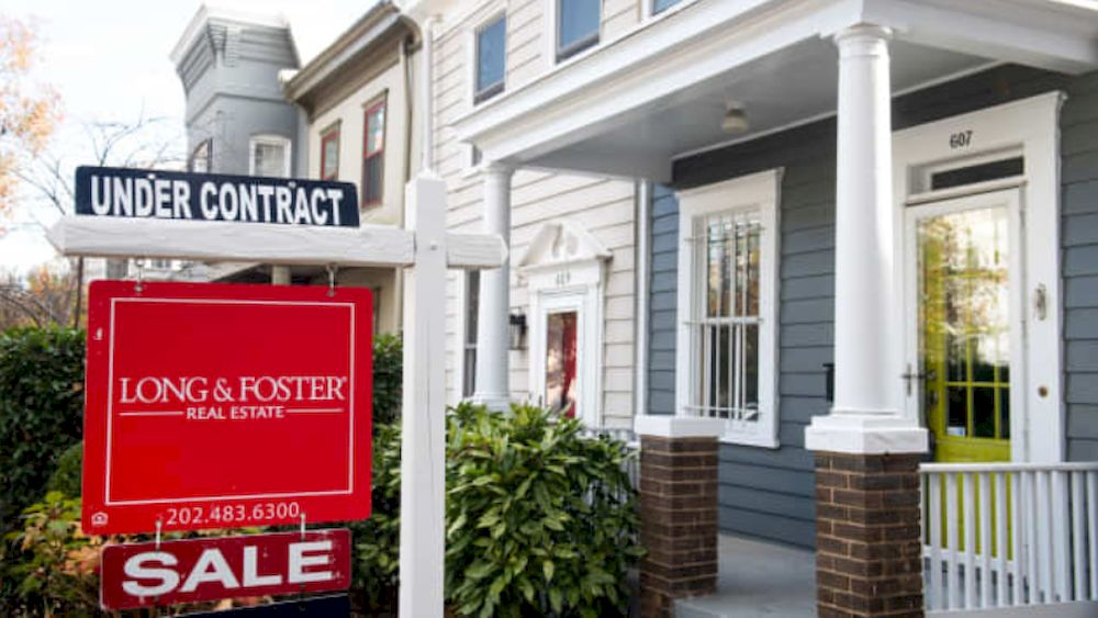 A house real estate for sale sign shows the home as being 'under contract' in Washington, DC, November 19, 2020. — AFP file pic