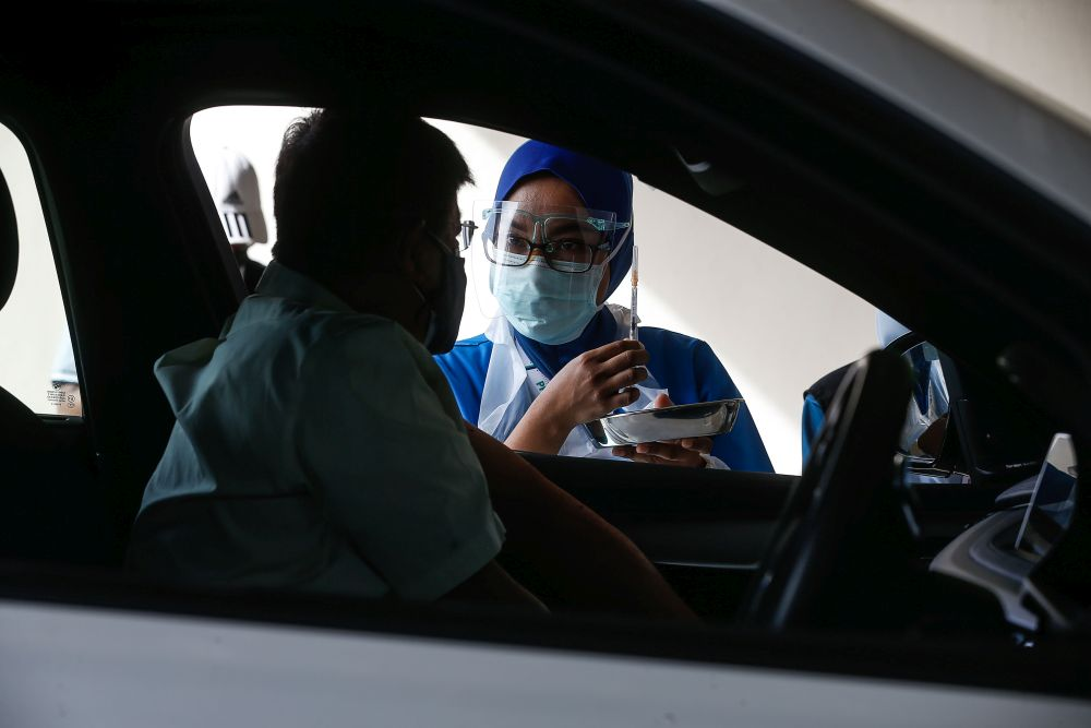 People receive their Covid-19 jab at Universiti Sains Malaysia's drive-through vaccination centre in Penang July 23, 2021. — Picture by Sayuti Zainudin